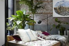 05 a neutral industrial space done with boho touches, animal skins, brickwork and potted plants make it catchy