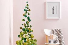 05 a small and elegant suspended Christmas tree of emerald and gold ornaments, shiny and glitter ones is an airy idea