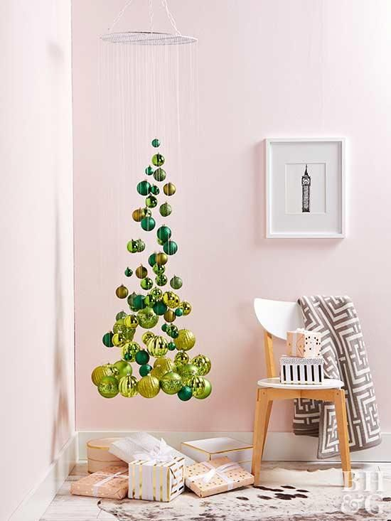 a small and elegant suspended Christmas tree of emerald and gold ornaments, shiny and glitter ones is an airy idea