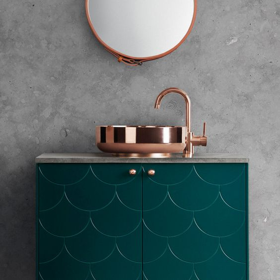 copper is a great idea to soften the space and make it more feminine, even if you have concrete or stone around