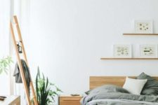 05 this minimalist bedroom looks very warm and welcoming due to a large amount of wood used in decor
