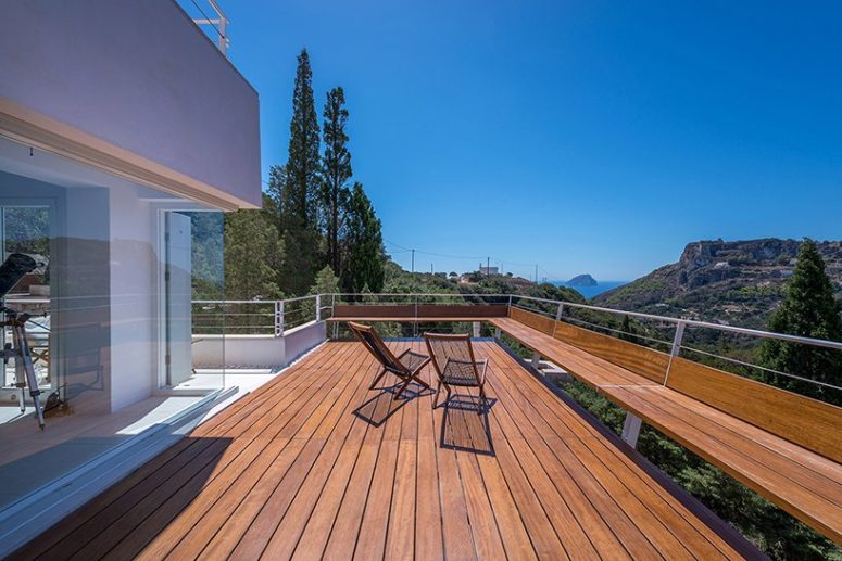 The main terrace features a bench along it and overlooks Kapsali Bay and Kythera Castle