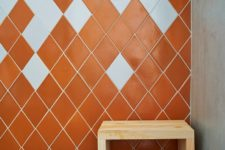 06 The master bathroom is done in orange and white tiles shaped as diamonds to highlight the jewelry inspiration