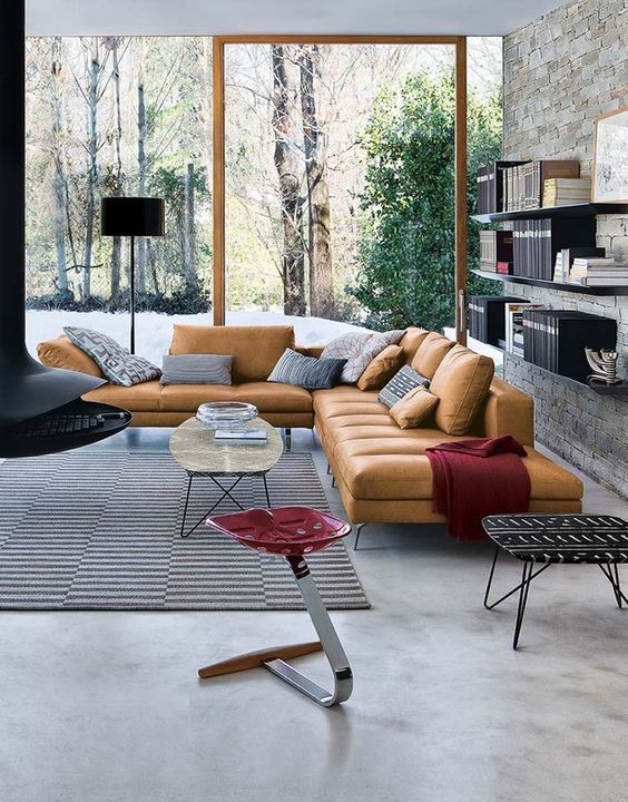 a contemporary living room with a glazed wall and a touch of color with accessories