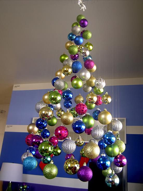 a super colorful floating Christmas tree of bright ornaments, shiny, matte and glitter ones