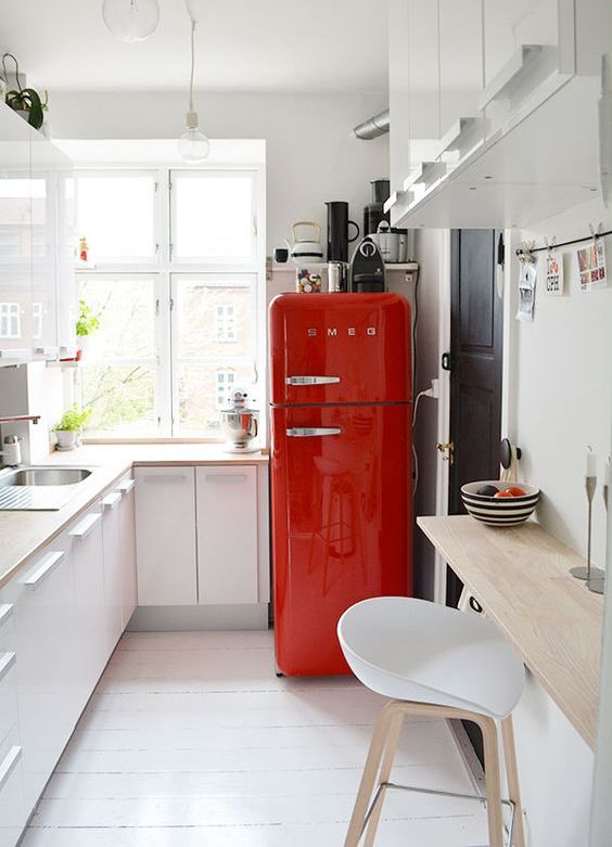 spruce up a neutral space with a bright red fridge from SMEG, such a fun idea