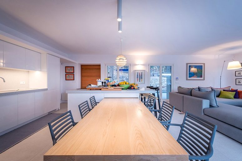 The main space is an open layout icnluding a kitchen, dining and living rooms
