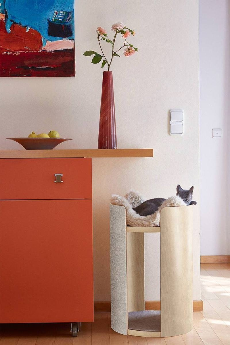 This tall and stylish cat bed is a scratcher at the same time and a faux fur throw for comfort