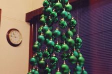 07 a small suspended Christmas tree of shiny, matte and glitter emerald ornaments hanging on different heights