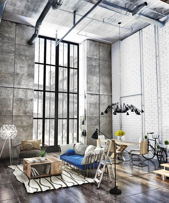concrete on the ceiling and walls and wood on the floor set the tones in this industrial space, it's in greys and browns