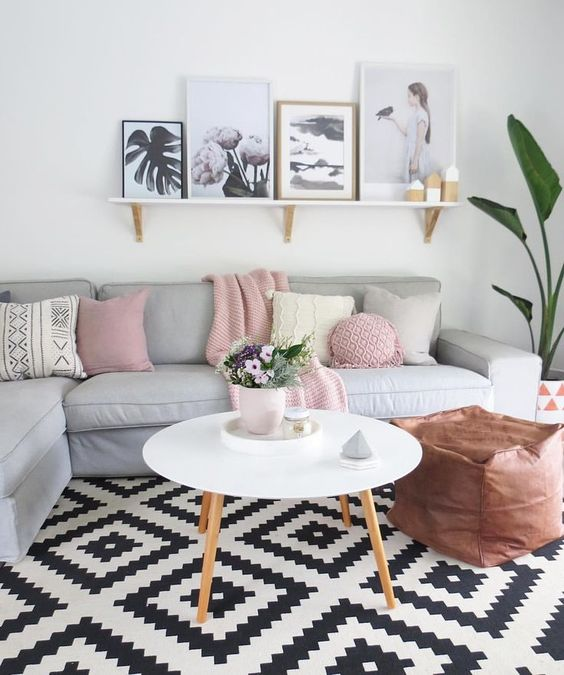 Scandinavian interiors have been dotted with color lately, like here with pink pillows and throws