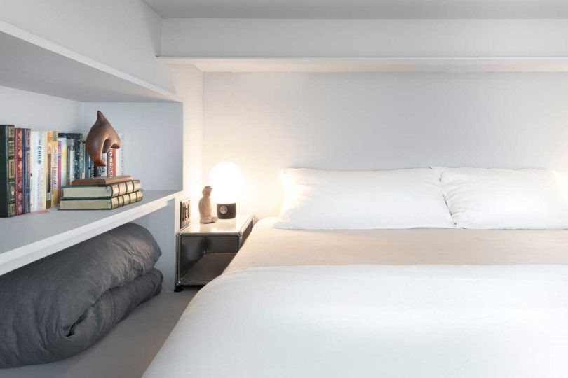 The bedroom isn't large, it's minimal and comfy for sleeping, there's open storage