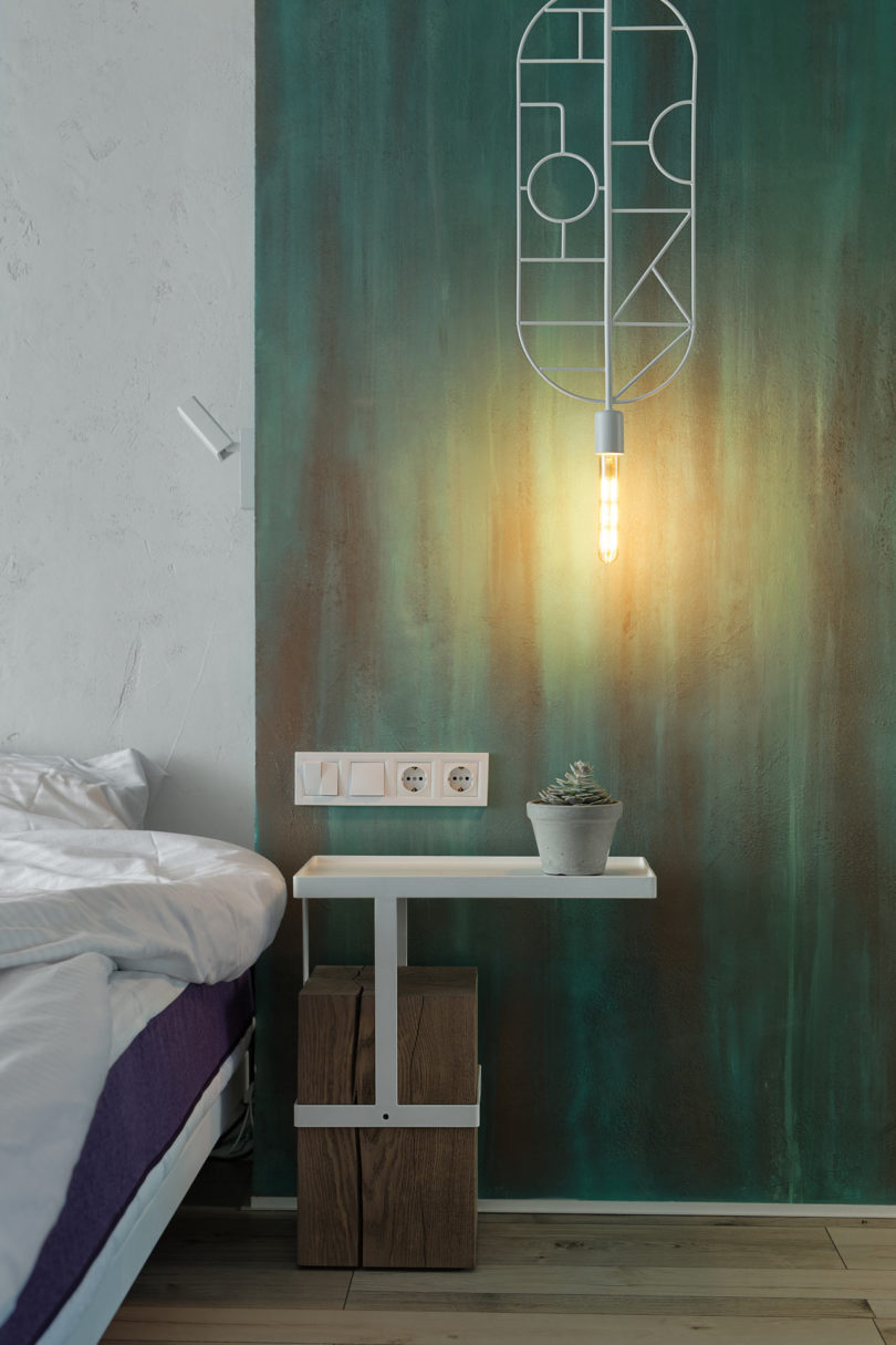 minimalist bedside tables made of tree stumps