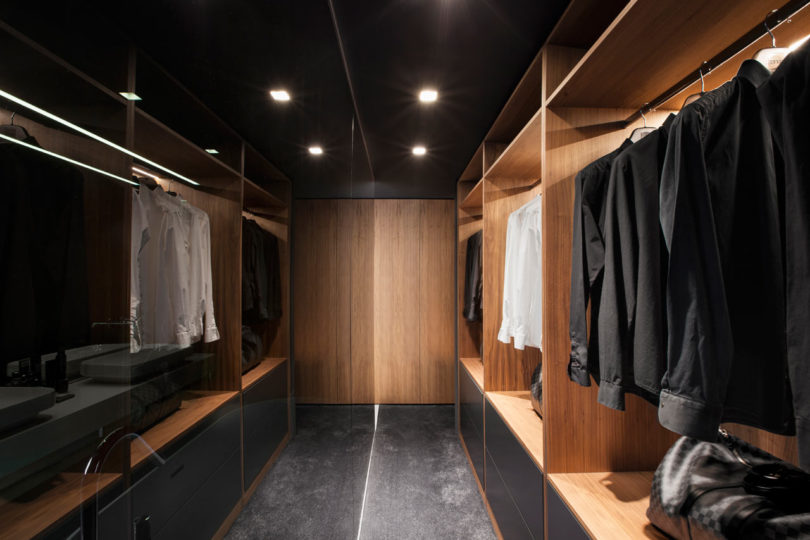 There's a comfortable closet next to the bedroom, done in the same color and material palette