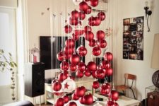 08 a large floating Christmas tree of matte and shiny Christmas ornaments and a couple of large white ones
