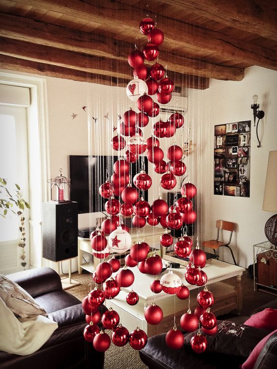 a large floating Christmas tree of matte and shiny Christmas ornaments and a couple of large white ones