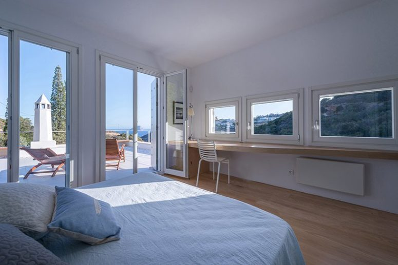 The master bedroom features a sleeping and working space and there's an entrance to the terrace