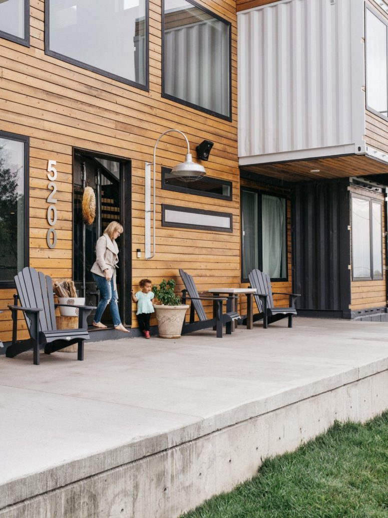 The outside deck is a concrete one, which makes it super durable, and there are some vintage wooden chairs