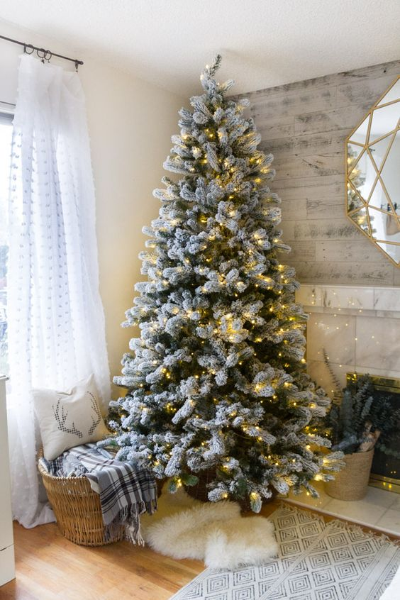 a flocked tree decorated with only lights for those who want maximize to a truly natural look