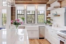 09 a modern rustic kitchen done in neutrals and with natural wood on the wall and matching on the floor