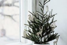 09 a planted Christmas tree in a white planter and with white plywood laser cut ornaments