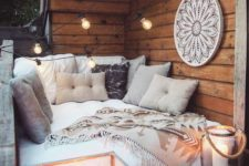 09 a small and cozy sofa, lots of pillows and throws, large candle lanterns and an oversized dream catcher