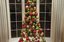 09 a suspended Christmas tree of ornaments in traditional Christmas colors, green, red and gold is a fun idea