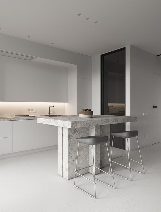 off-whites and greys make the kitchen airy, a stone kitchen island highlights the texture