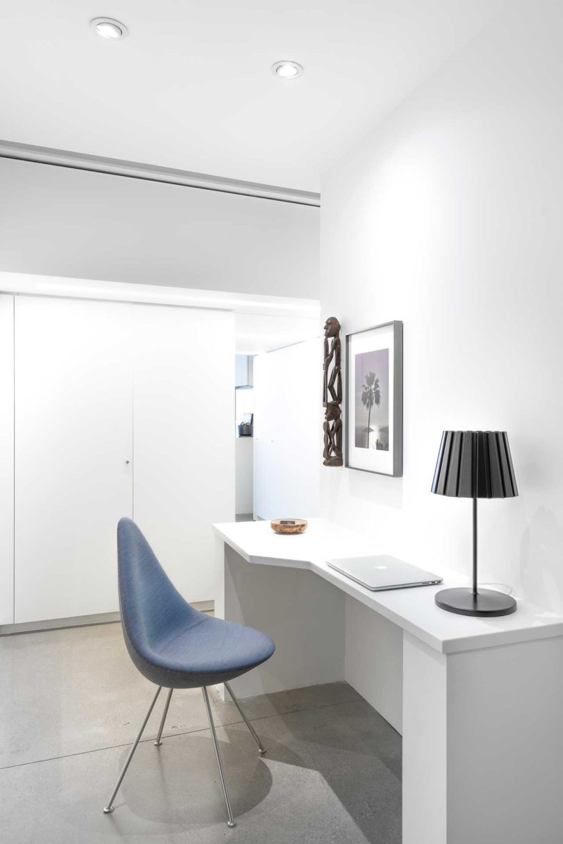 The home office nook is done comfortable, with a stable desk, a stylish chair and refined artworks