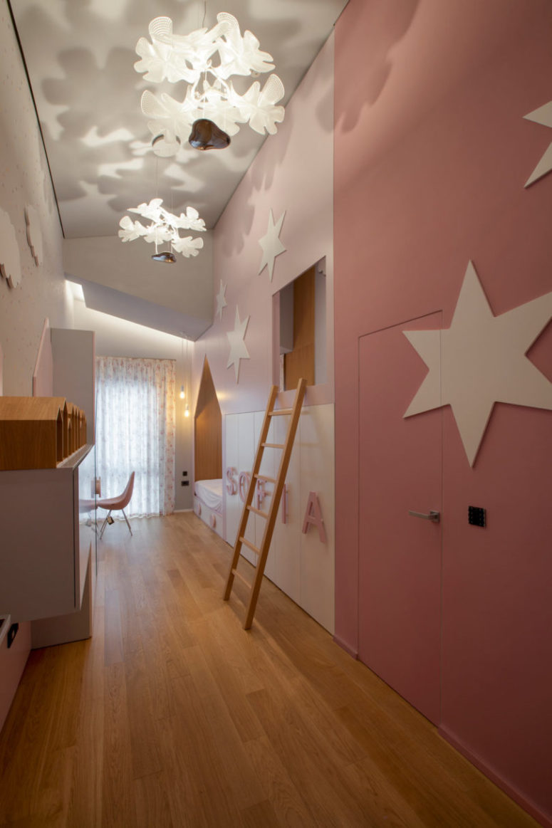 The kid's room is done in pink and white, though it's rather long and narrow, there's everything necessary