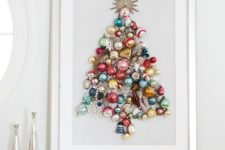 10 a beautiful colorful Christmas tree made of ornaments on a sign is a chic idea of an additional Christmas tree