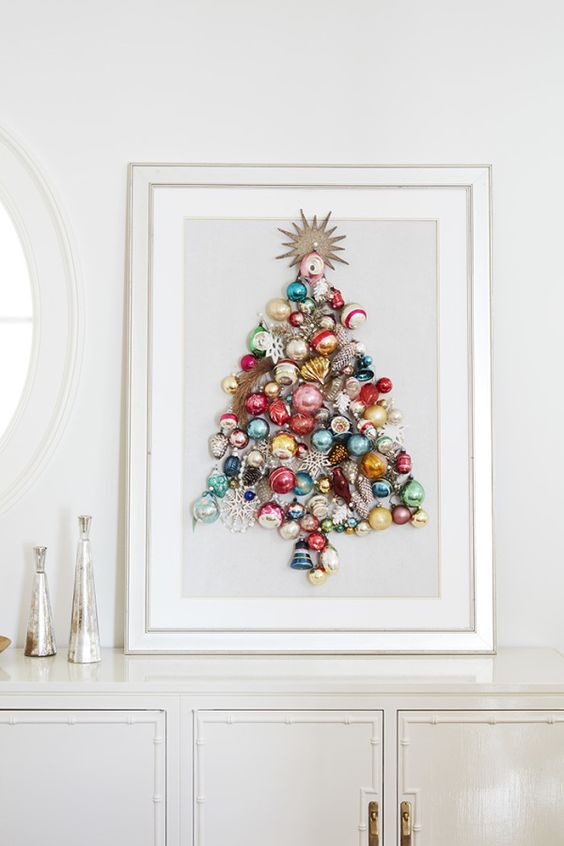 a beautiful colorful Christmas tree made of ornaments on a sign is a chic idea of an additional Christmas tree