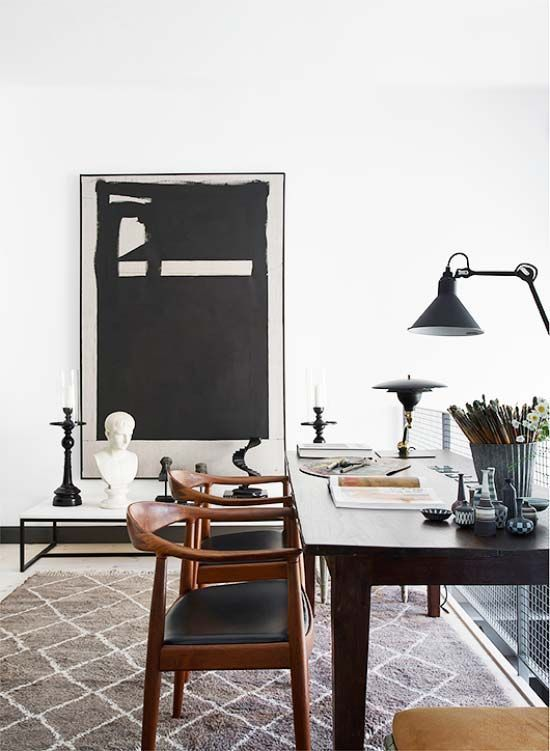 a graphic moody artwork is a perfect fit for the space, it screams masculine in this home office