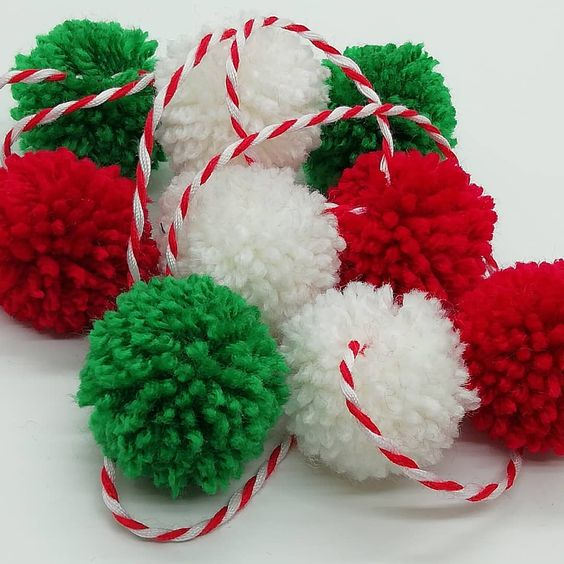 a pompom garland in traditional Christmas color and with a striped string will be a budget savvy and fun decoration