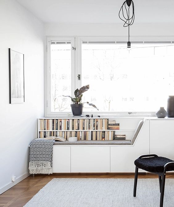 create a window seat to match the style of your home office, place books next to it if needed