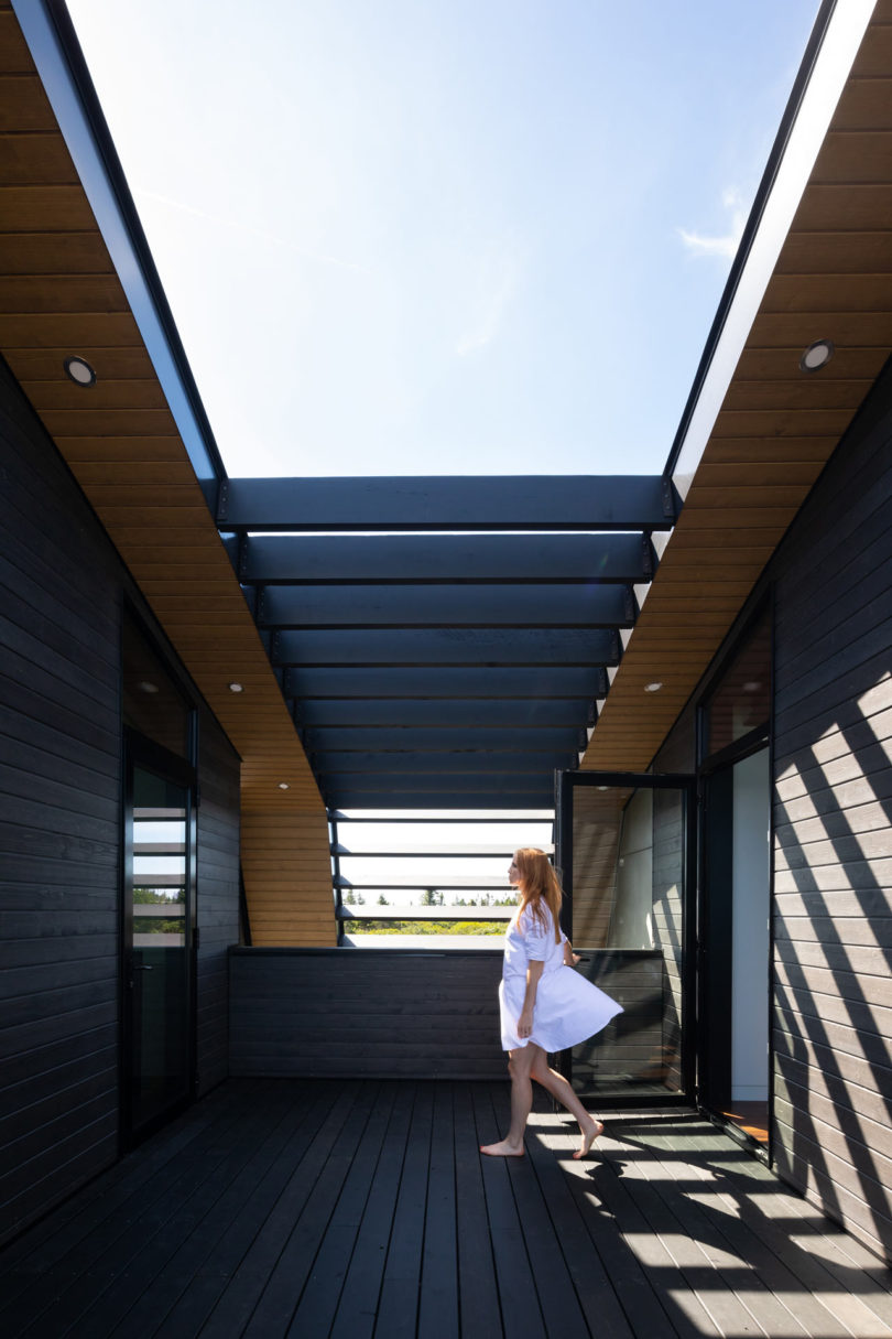 The wood is stained dark to continue the dark exterior color of the house