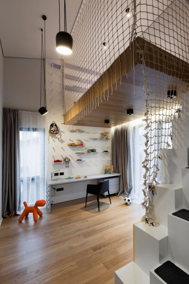 This is a kid's playroom and study space, done in neutrals and white and filled with light