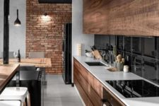 11 a cozy modern kitchen with rustic details and touches incorporated there, and an industrial brick wall