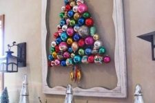 12 a colorful ornament Christmas tree formed right on the wall and highlighted with a vintage frame is a creative idea