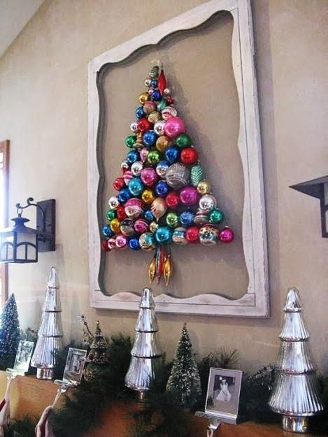 a colorful ornament Christmas tree formed right on the wall and highlighted with a vintage frame is a creative idea