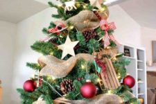 12 a gorgeous rustic Christmas tree with pinecones, wooden stars and sledges, red balls and plaid bows, a star on top