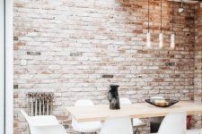12 an all-neutral space spruced up with a single vintage brick wall  and a vintage metal stand