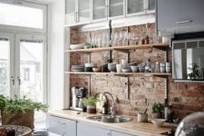 12 an exposed brick wall and wooden countertops for a modern rustic kitchen