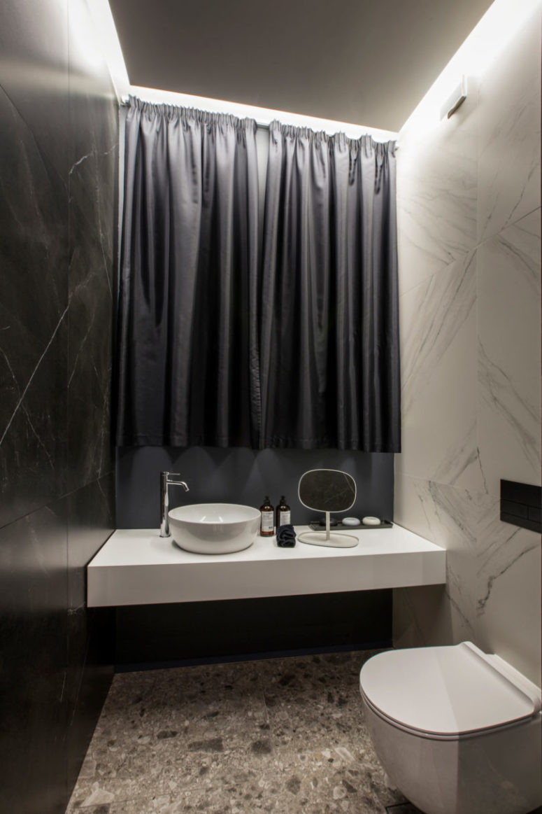 There's also a modern sink and a large window covered with a curtain