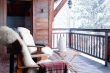 13 a couple of wooden chairs covered with faux fur, plaid blankets and a small folding table plus a gorgeous view