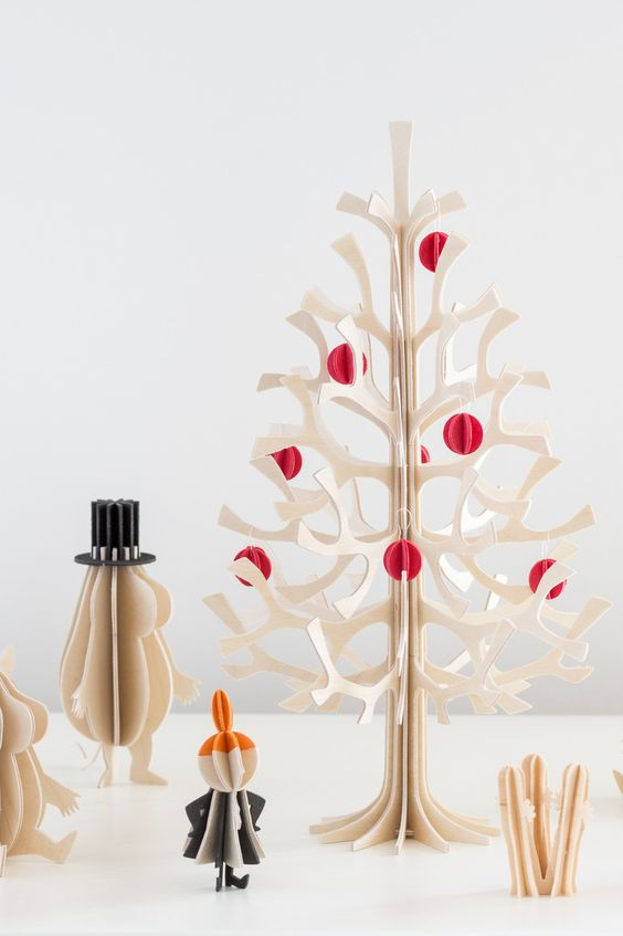 a laser cut plywood Christmas tree with colorful 3D paper ornaments is a cool table version