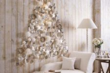 13 a subtle white Christmas tree of white ornaments and fluffs plus a star on top is realized right on the wall