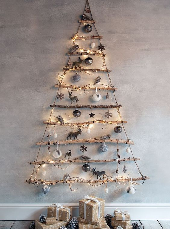 a simple Christmas tree of branches decorated with lights and neutral ornaments for a rustic feel in your space