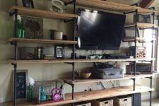 14 an industrial shelf unit of pipes and wood is ideal for lofts and other industrial spaces