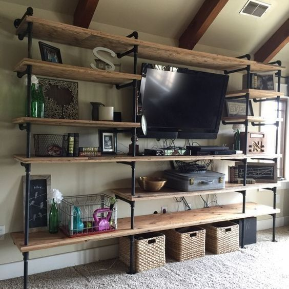 an industrial shelf unit of pipes and wood is ideal for lofts and other industrial spaces